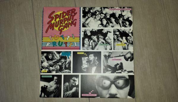 LP Spider Murphy Gang Tutti Frutti [Vinyl LP] 180g - Leverkusen - Spider Murphy Gang ?- Tutti Frutti [Vinyl LP] 180g EMI Electrola ?- 1C 066-46 671 Veröffentlicht: 1982 Pop Rock(180g/Remastered) [Vinyl LP]Tracklisting: 1. Liebe ist gesund 2. Ich schau`` dich an (Peep Peep) 3. Reißverschluss 4. Sommer in d - Leverkusen