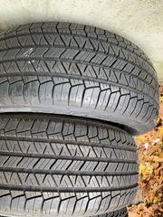 2x neuwertig Allwetter Reifen 235