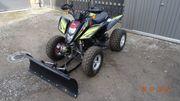 ATV mit Schneeräumschild