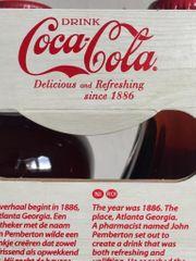 2 Coca Cola lachen 0