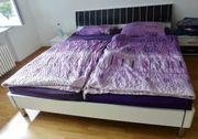 Schlafzimmerbett weiß schwarz