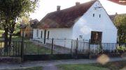 Haus mit Holzbalkendecke,
