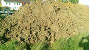 Erdaushub mit Mutterboden